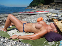 Topless Milf On A Beach