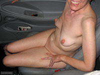 Nude In A Car