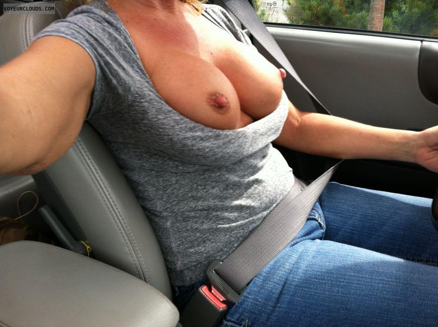 My wife flashing tits in car