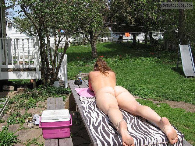 Sexy girl nudist doing yard work happiness!