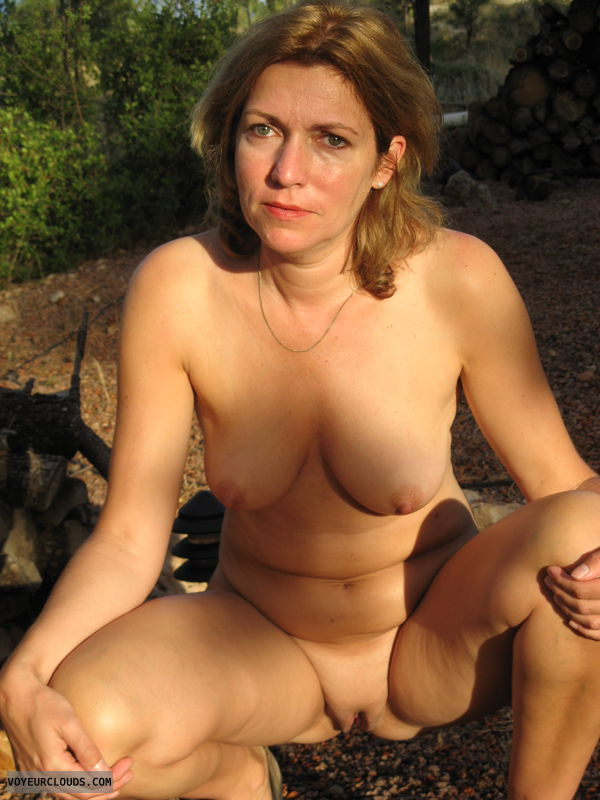 Nude girl, bald pussy, outdoors pic, small tits