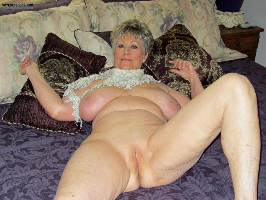 Mature big tits shaved pussy