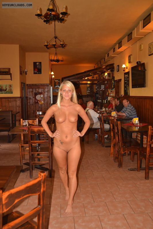 Nude blonde woman in a bar