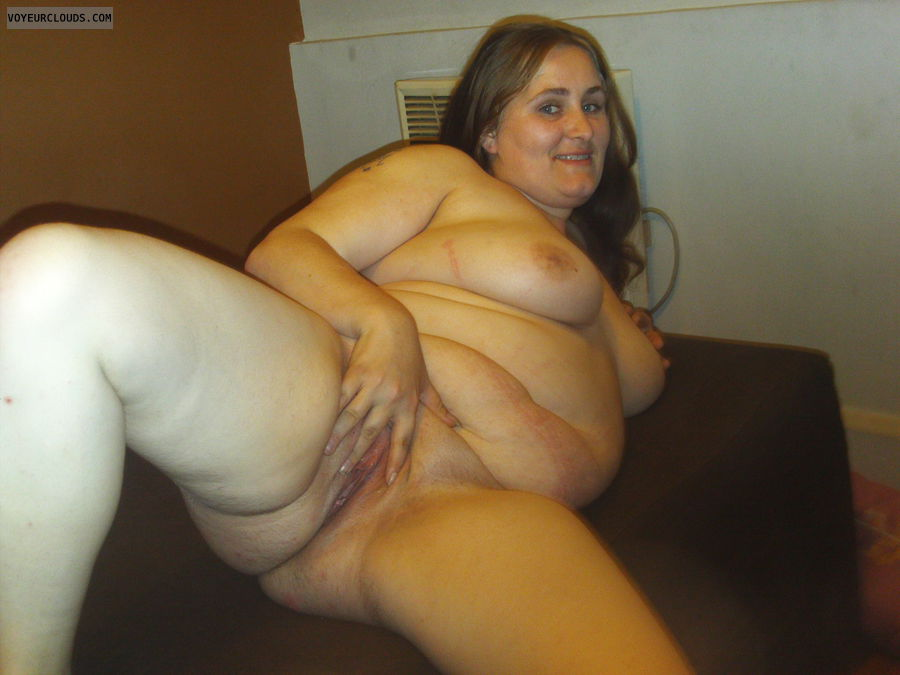 woman naked covering pussy
