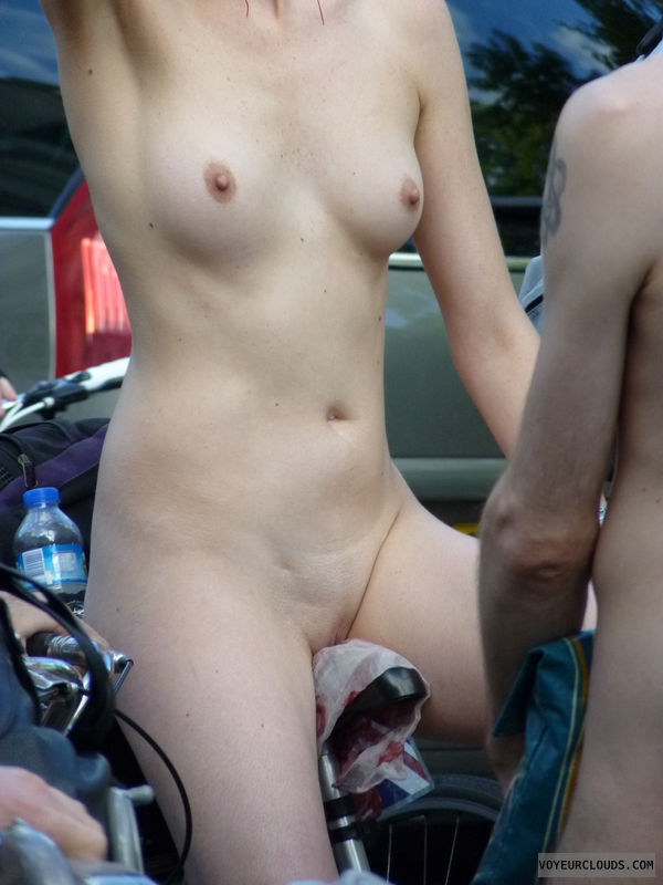 nude woman, small tits, exposed in public, shaved pussy