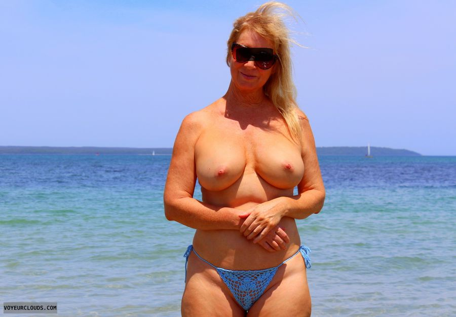 Big boobs, topless blonde, hard nipples, beach pic