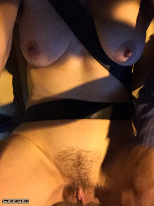 naked in car, trimmed pussy, medium tits, hard nipples
