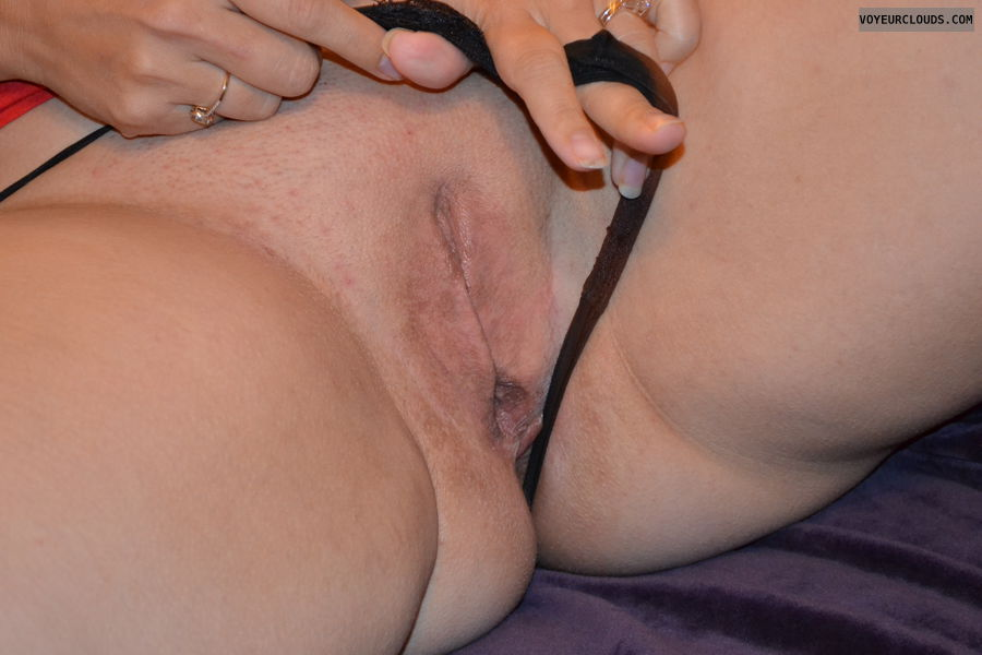 shaved pussy, pussy lips, spread legs, thong pulled to the side