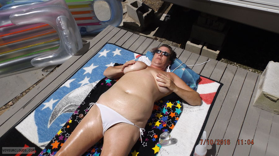 topless suntanning, topless, rubbing tits, tit, big tits