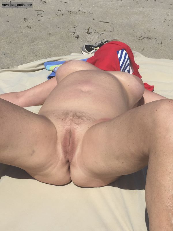 nude wife, spread legs, shaved pussy, large tits, beach pic