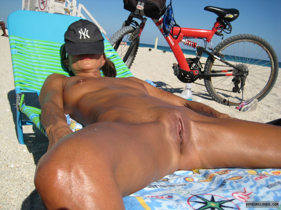 nude beach, shaved, legs wide open