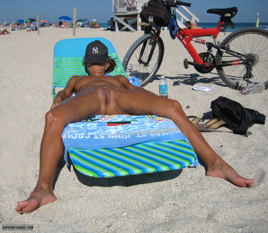nude beach, shaved, tanned, legs wide open