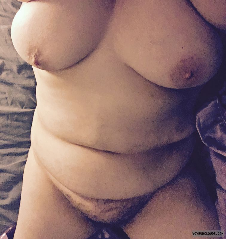 Nude MILF, topless, big tits, hairy pussy