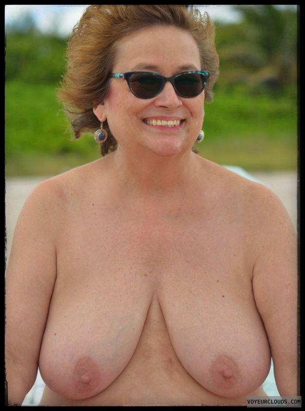 Big tits, sexy smile, milf, nude beach