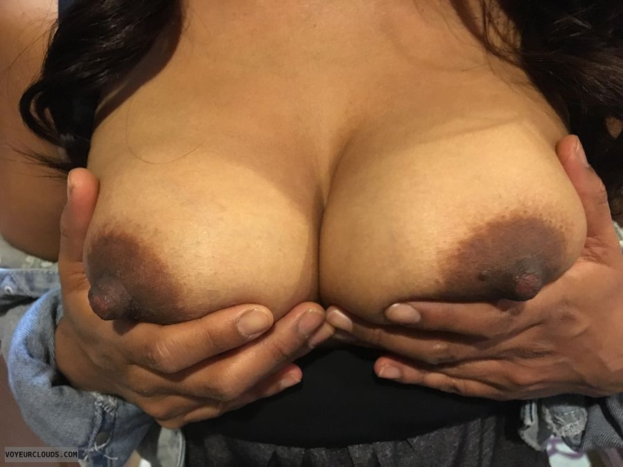 tits out, hard nipples, dark areolas, hand bra