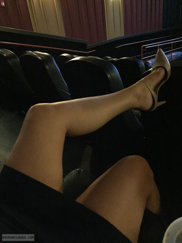 MILF legs, heels, dress, tease, movie theater