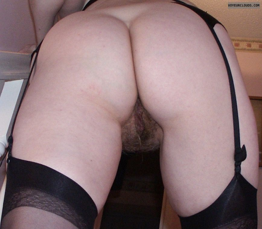Ass cheeks, rear pussy, stockings, suspenders, on stairs