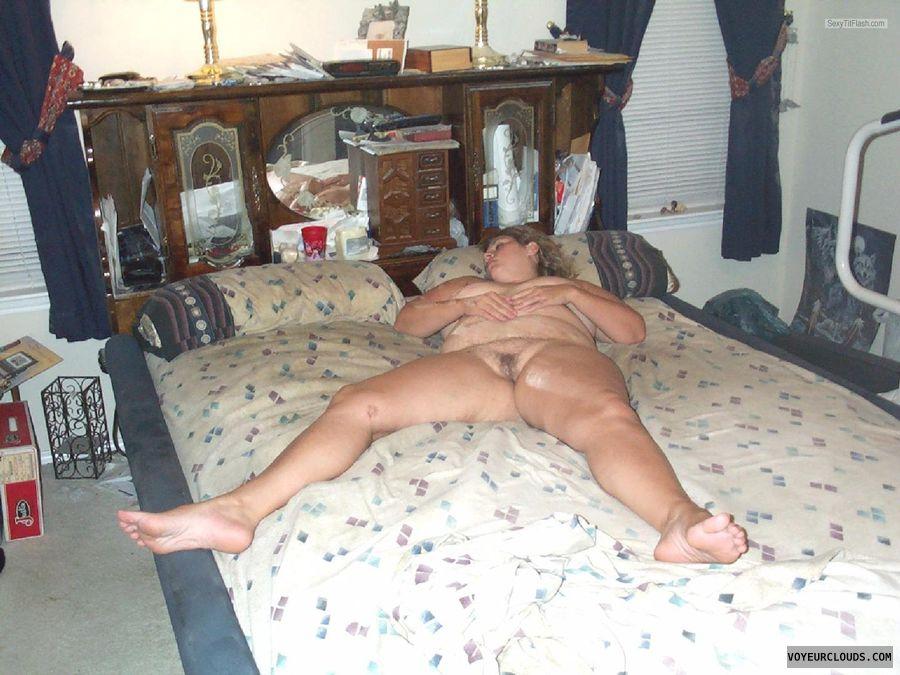 nude woman, big tits, pussy lips, spread legs