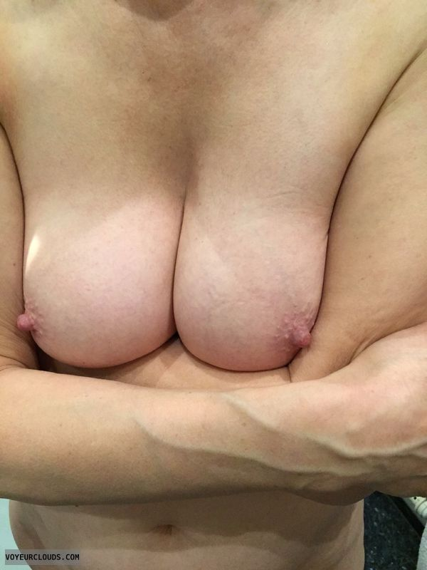 nude wife, hard nipples, deep cleavage, hand bra