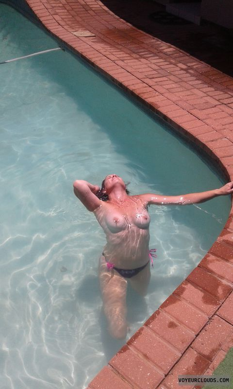 Topless, hard nipples, swimming pool, tanlines, teasing