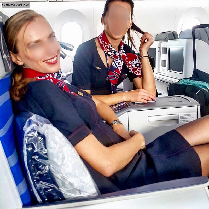 In mini at work, uniform, stewardesses, sexy smile