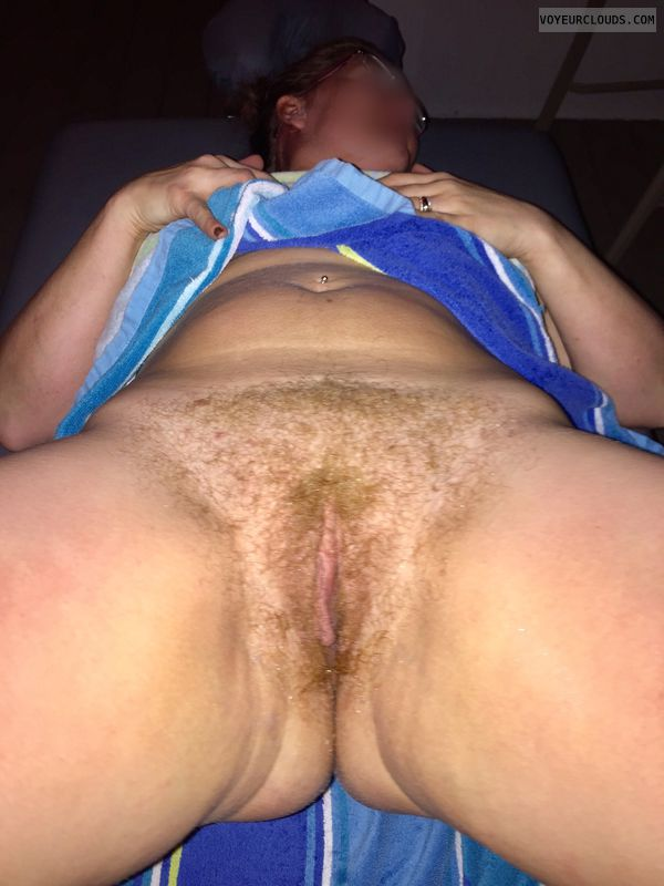 full bush, ginger, massage table