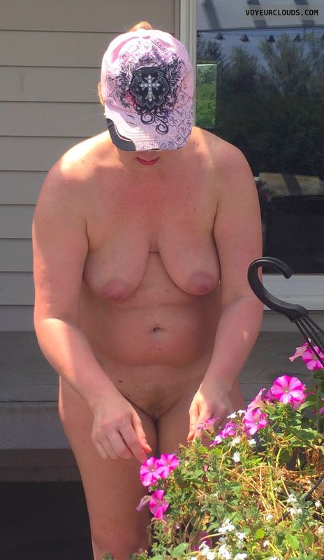 Saggy tits, large areola, ginger, back yard
