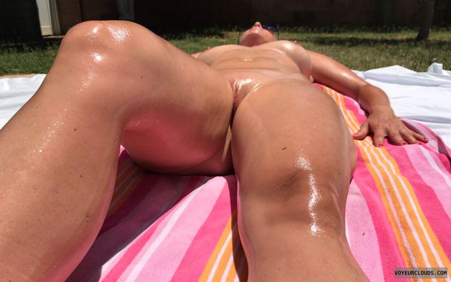 nudist, suntanning, tanning, naked, oiled, milf, baldpussy