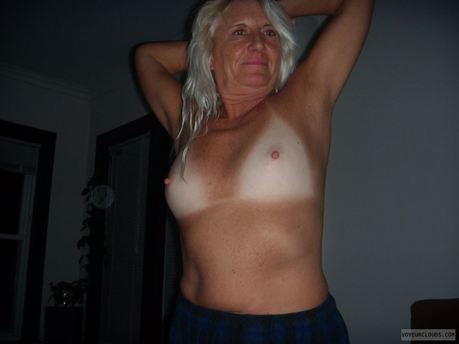 Hard nipples, big boobs, topless, tan lines, blonde