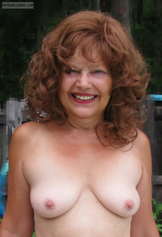 Topless, hard nipples, nice tits, red head