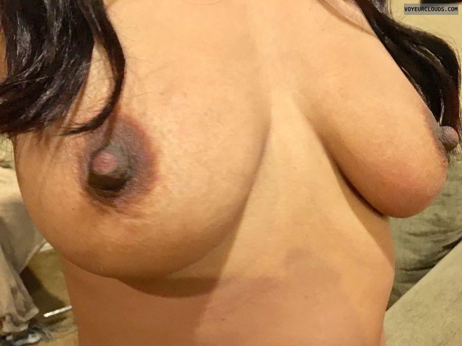 hard nipples, dark areolas, topless, arms up, big boobs